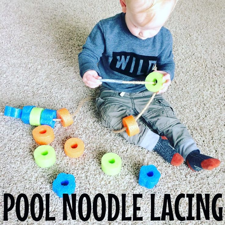 """Pool Noodle Lacing ♀️ My son loves the ALEX Toys farm lacing bead set that we have, so I thought he might love using pool noodle pieces to do the same! I cut a piece of rope, tied a pool noodle to one end for a stopper, and duct taped the other end for a """"needle"""" (see second picture). He knew just what to do and got to work threading the pool noodles! The Dollar Tree has pool noodles in-store again and it only took me a few minutes to cut them up using a bread knife."""