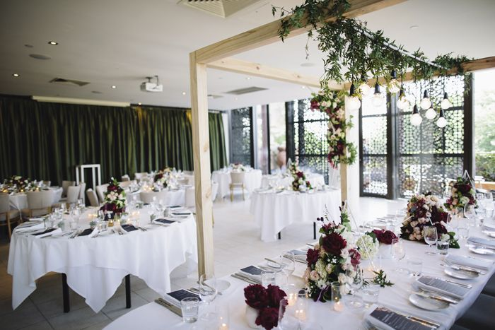 #wedding, room arrangement, flowers, table arch, four post, design, inspiration, #arch #weddingarch #wedding #styling #weddingflowers, marriage, green, spring Styling by The Style Co, Melbourne, Circa, , shoes, photography by Leo Farrell, venue Circa the Deck St Kilda
