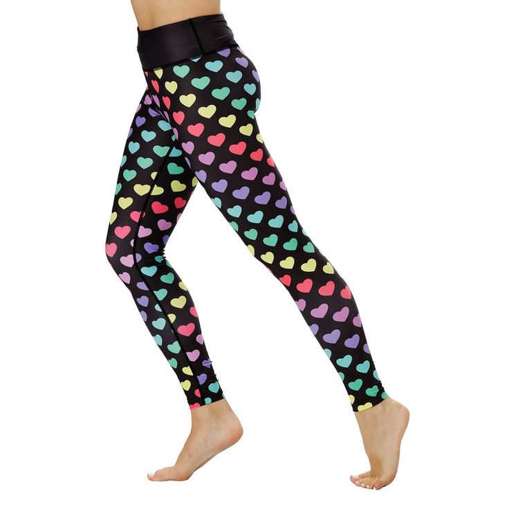 Channel your inner 80s chick with these stunning disco-inspired heart print workout leggings.  Showcasing all the colours of the rainbow, you're bound to make a splash in the gym with this outfit. Designed as part of our exclusive rainbow range, you can rest assured that these workout leggings are squat-proof and comfortable for a full range of movement. #Activewear #Gymwear #FitnessLeggings #Leggings #Tikiboo #Running #Yoga