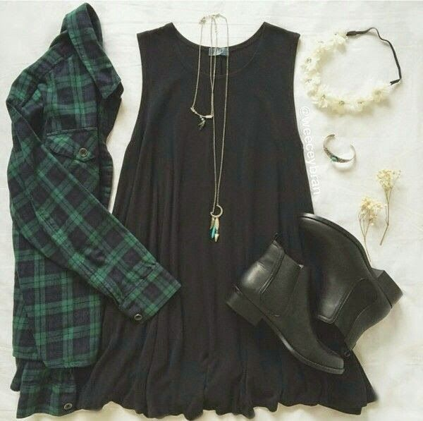 Green plaid flannel paired with a black tank dress and black ankle booties. Very Grungy