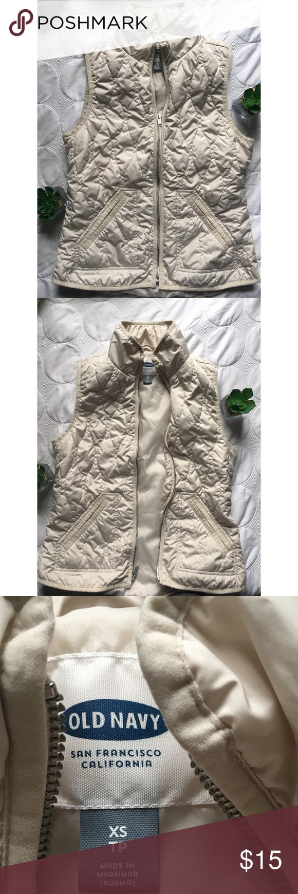 Cream old navy vest Cream old navy fall vest! Great condition only worn a few times! Zipper works perfectly! No rips or stains! Size x small! Old Navy Jackets & Coats Vests