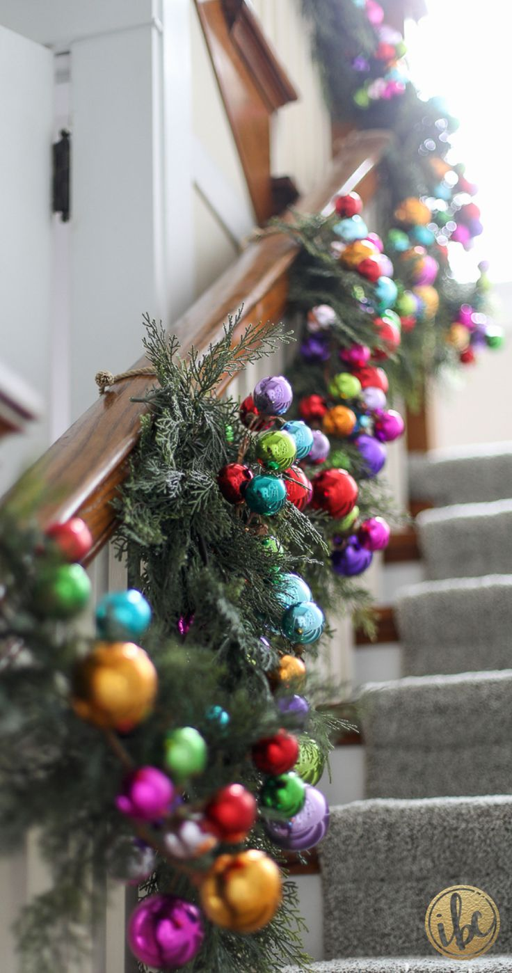 Colorful Christmas Banister Garland | Holiday Home Tour via inspiredbycharm.com