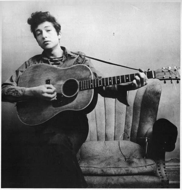Bob Dylan playing guitar, 1963.