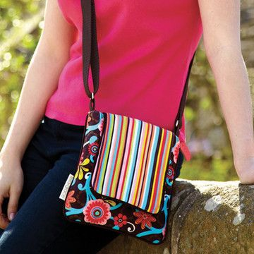 The adjustable Cross-Body Handbag will become your everyday favorite. With a zip pocket on the back for quick secure access, this cross-body bag can keep your essentials organized on the go.