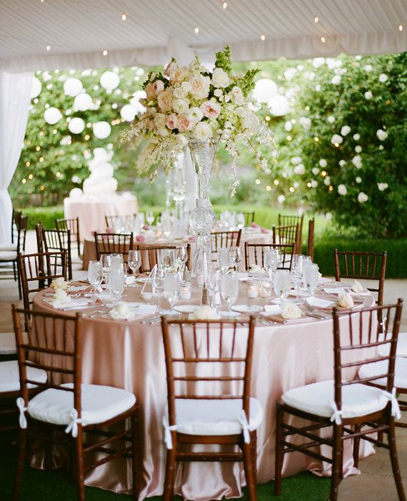 blush wedding details table scape of blush pink linens and tall flower vases
