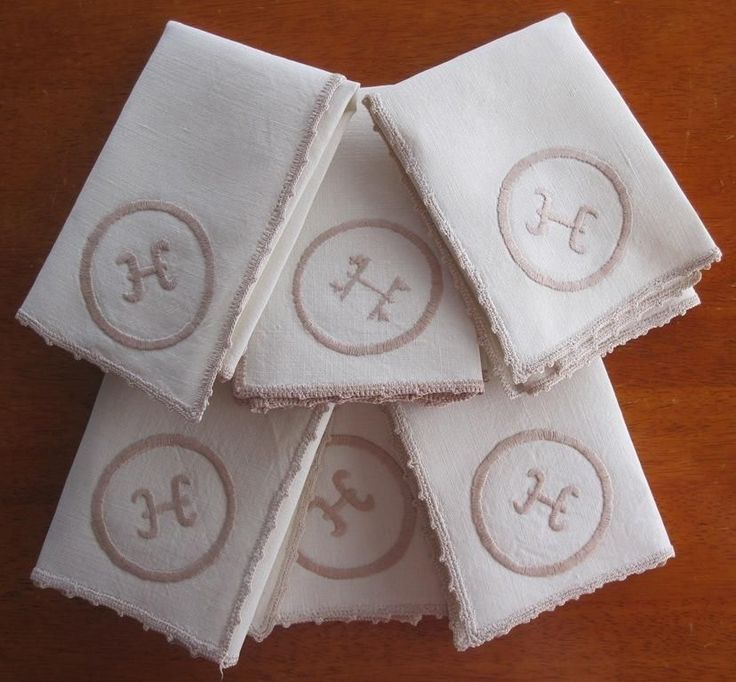 Set of six hand embroidered table napkins corner emblem