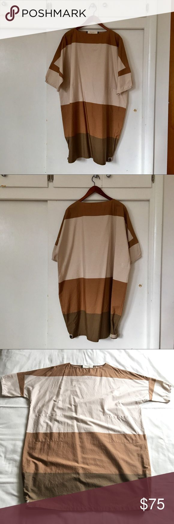 """Marni oversized dress ⚠️Price is firm, no offers accepted  Very good used condition without noticeable blemishes (worn just twice) Sleeve length altered, the end of sleeves and bottom hem sides got modified by me (I do sewing, make my clothes), originally everything had just straight cut Crisp high gauged quality lawn cotton fabric  Dual patched pockets Fairly narrow neck opening (approx 21.5"""" circumference) Italian size 40 27"""" bust, 38"""" length  Made in Italy Marni Dresses Midi"""