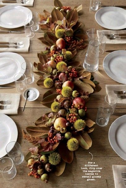 Freeform garland (no wires) of fruits like crab apples and pomegranates, magnolia leaves, dried flowers like amaranth, and garnished with chestnuts, berries, and small autumn foliage on top.