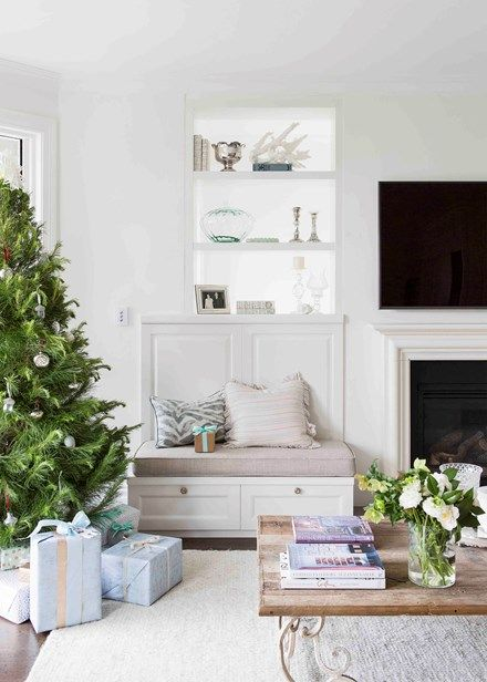 Fresh trees, garlands and wreaths on the mantles and the staircase   White Christmas - Home Beautiful Magazine Australia
