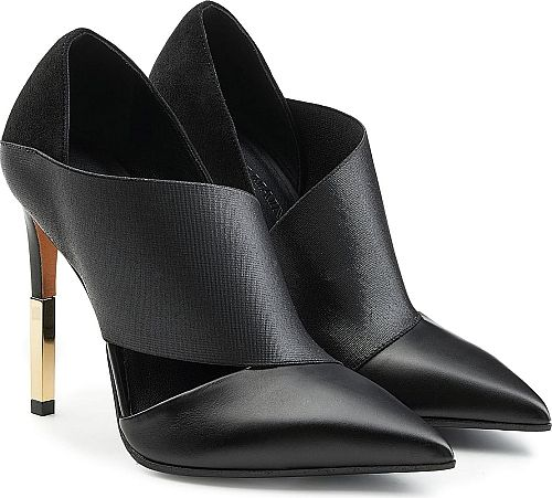 Balmain Women's Shoes in Black Color. These black pointed 'Audrey' pumps from Balmain are crafted from supple leather and soft suede for the most elegant and tactile finish. A stiletto heel with gold-tone hardware lends gloss while a cut-out panel on the side shows off a hint of skin.
