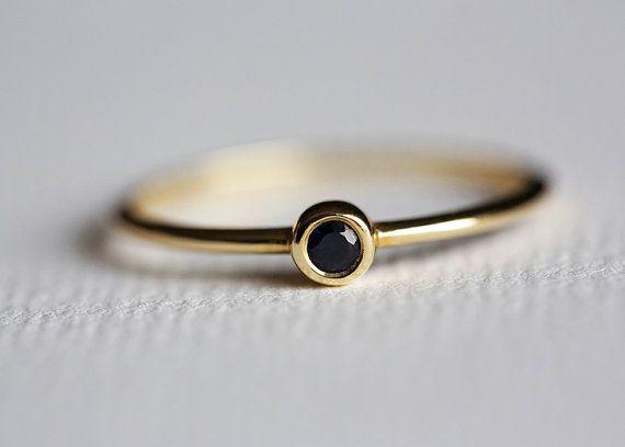 Tiny Solitaire black diamond ring. Love everything my Minimal VS!
