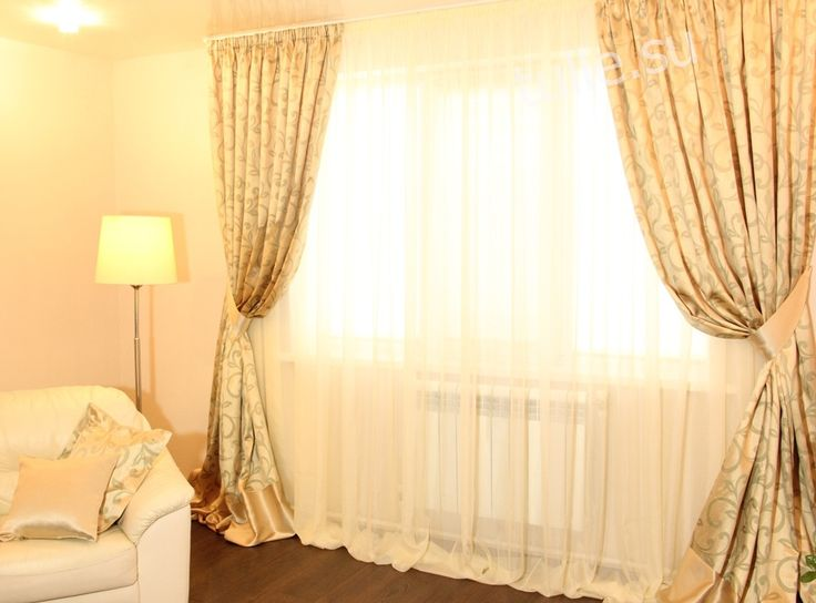 Drapes with pickups and tulle in Golden tones. The curtain is assembled into a uniform fold and supplemented with cross inset companion.  Дизайнер штор: Альмендеева Наталья