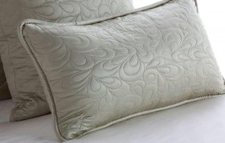 """Quilted Lumbar Pillow. Our quilted lumbar pillow features a distinctive """"flowing leaf"""" pattern on a 100% mulberry silk charmeuse facing paired with a pure cotton backing. Available in many colors. 