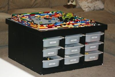 Make a lego table. Looks like it could actually make a beautiful coffee table if you covered the bins with cupboards and  put on some sort of topper. Legos for every day, coffee table for guests...so need tp do this for son's legos!