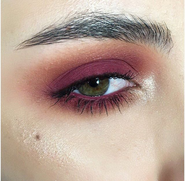 Cranberry eye makeup.