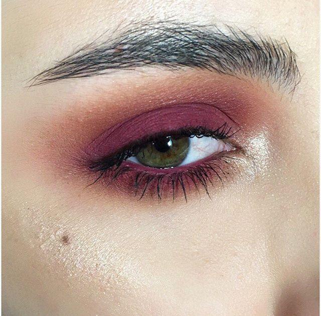 Cranberry eye makeup.