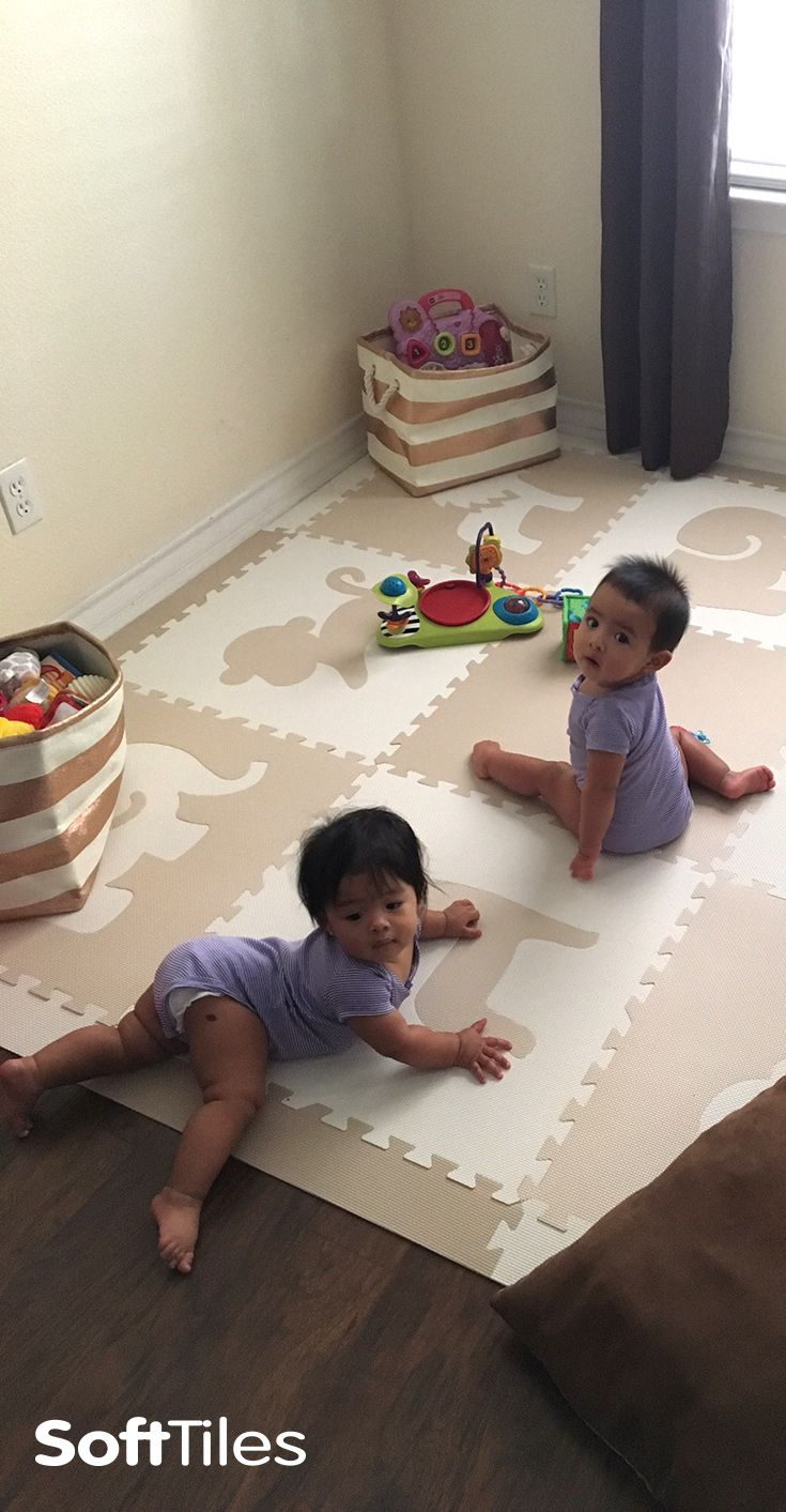 SoftTiles Safari Animals with Borders Tan, White is a neutral colored play mat that's perfect for creating a designer nursery or playroom in a mixed use space like a living room. This set also looks p