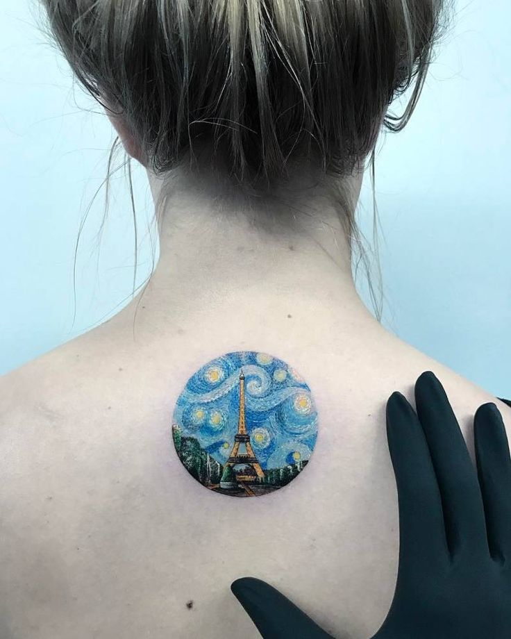 The Starry Night inspired Eiffel Tower tattoo on the upper back.