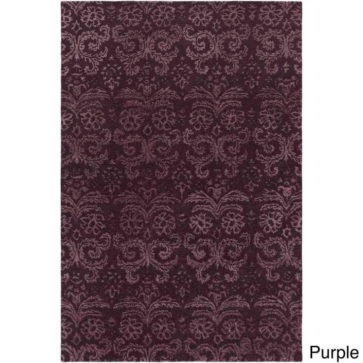 Pull together any setting with this contemporary area rug. Hand-Tufted with 50-percent viscose,50-percent wool, this damask rug is sure to be the finishing touch you've been searching for. Primary mat