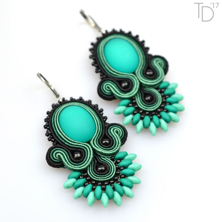 »Fans II.« soutache earrings with UV glass cabochon, TOHO seed beads, Superduo beads, Czech pressed rounds, Czech soutache braids, leatherette, and stainless steel findings.