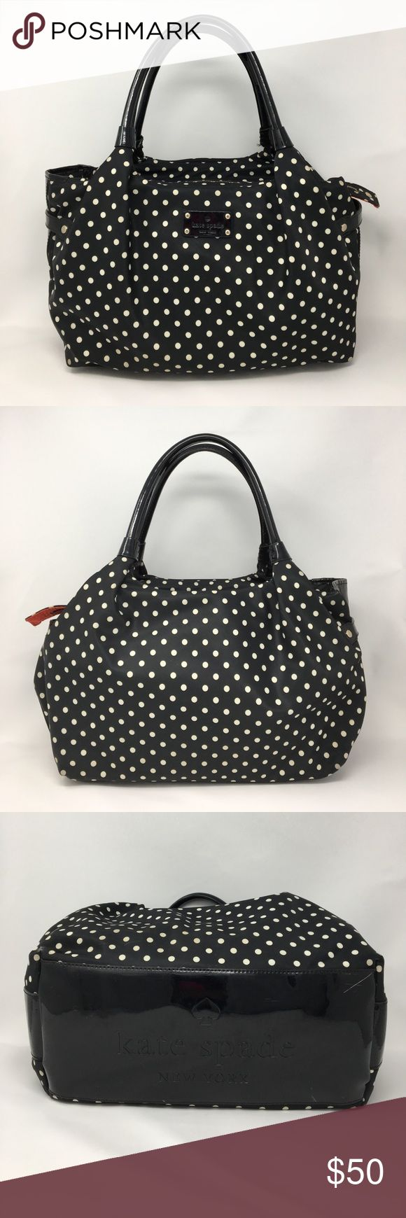 Kate Spade Nylon Polka Dot Tote Bag Kate Spade Nylon Polka Dot Tote Bag. Size 13x5.5x10 inches. Black with White Polka Dots. Red lining. Zipper closure. Inside zip pocket and on the other side two open pockets. Used condition. Minimal wear. Still in very good condition. NO TRADES! kate spade Bags Totes