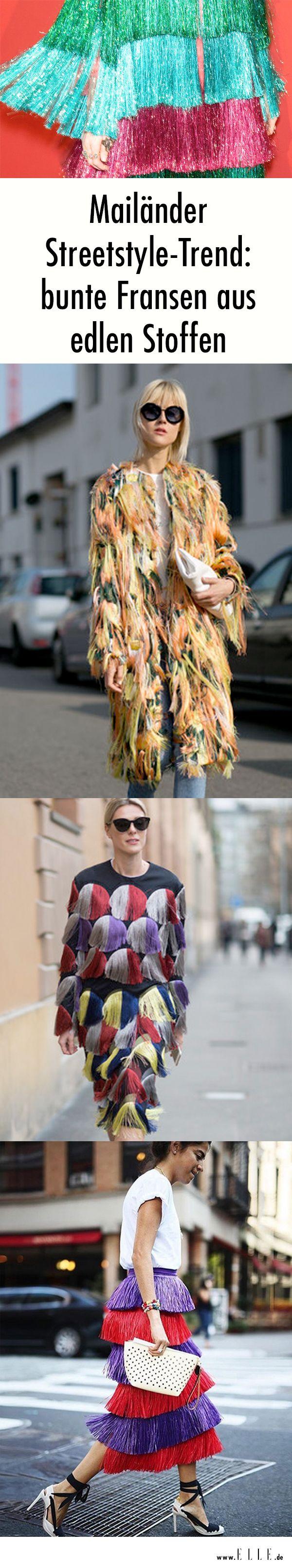 Mailänder Streetstyle-Trend: Egal ob Kleid, Mantel oder Rock – bunte Fransen aus edlen, schimmernden Stoffen werden wir demnächst wohl auch in unsere Kleiderschränke hängen.