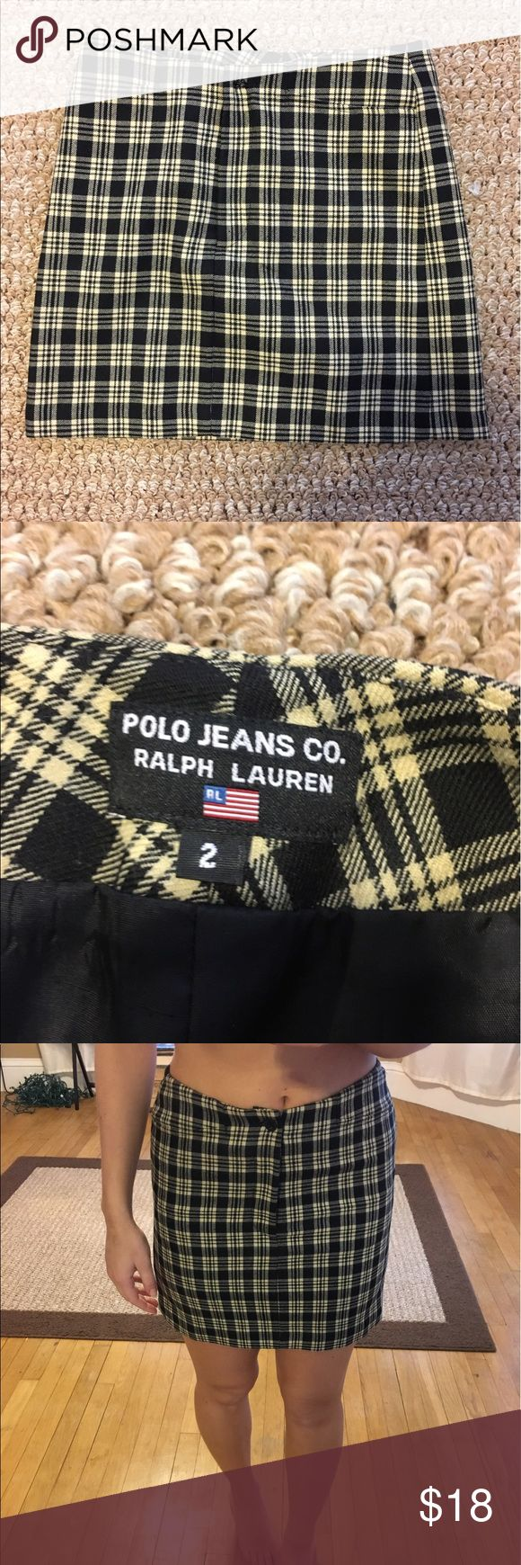Vintage polo mini skirt size 2 Black and tan print. Has two pockets in the front with a zipper and a button. I wear it high waisted (I'm a 27 in pants). Polo by Ralph Lauren Skirts Mini