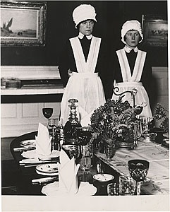 Parlormaid and Under-Parlormaid Waiting to Serve Dinner, London, 1939, photo by Bill Brandt (British).