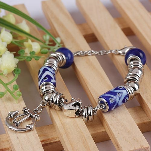 Cheap Costume Handmade Fashion Dark Blue Cylindrical Alloy Acrylic And Glass Bracelet With Bow And Arrow Pendant