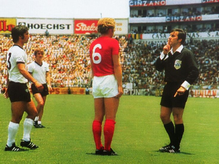 West Germany 3 England 2 in 1970 in Leon. The referee has a word with Gerd Muller and Bobby Moore in the World Cup Quarter Final.