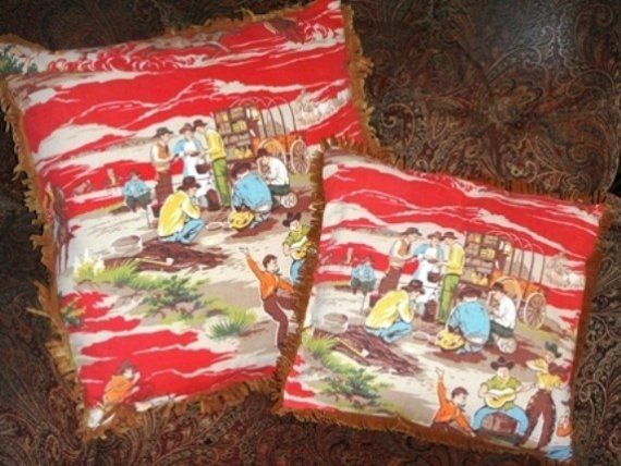 Price Reduced!!!  These two darling pillows (14 and 19)are made with vintage cowboy fabric, complete with suede like fringe. The vintage fabric is on both front and backs of the pillows. Also included are 3 matching valances (1-8.5 x 45 and 2-8.5 x 64). These would be perfect for a little buckaroos bedroom or nursery! If shipping outside the US, please convo me for exact shipping.