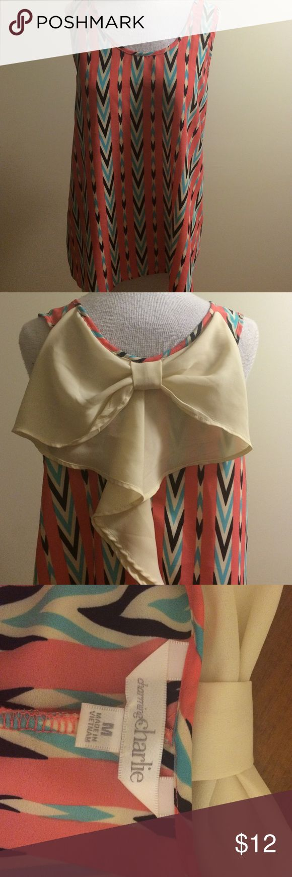 Charming Charlie Tank Top Multi colored pink blue and white tank top / tunic! With flown back white bow detail! Charming Charlie Tops Tank Tops