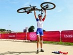 Julie Bresset of France celebrates winning the Women's Cross-country Mountain Bike race  / Action from Day 15 - London 2012 Olympics