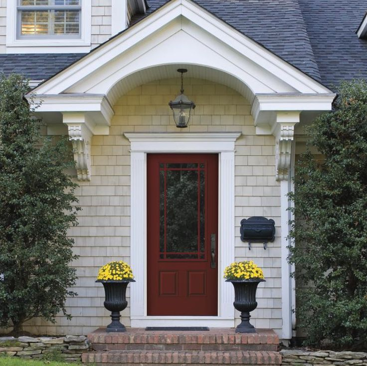 Stand out contrasting colors draw the eye to your front for Front door with three windows