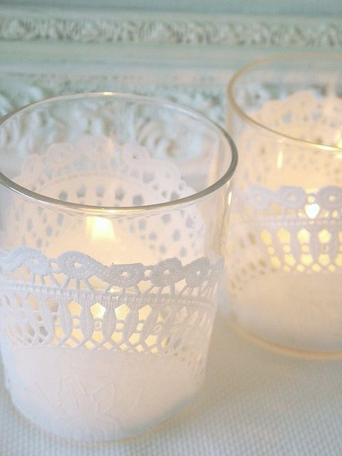 candle glasses with paper doilies