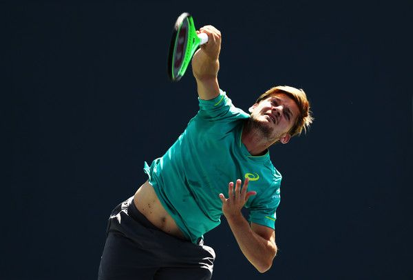 David Goffin Photos Photos - David Goffin of Belgium serves to Julien Benneteau of France during their first round Men's Singles match on Day Three of the 2017 US Open at the USTA Billie Jean King National Tennis Center on August 30, 2017 in the Flushing neighborhood of the Queens borough of New York City. - 2017 US Open Tennis Championships - Day 3