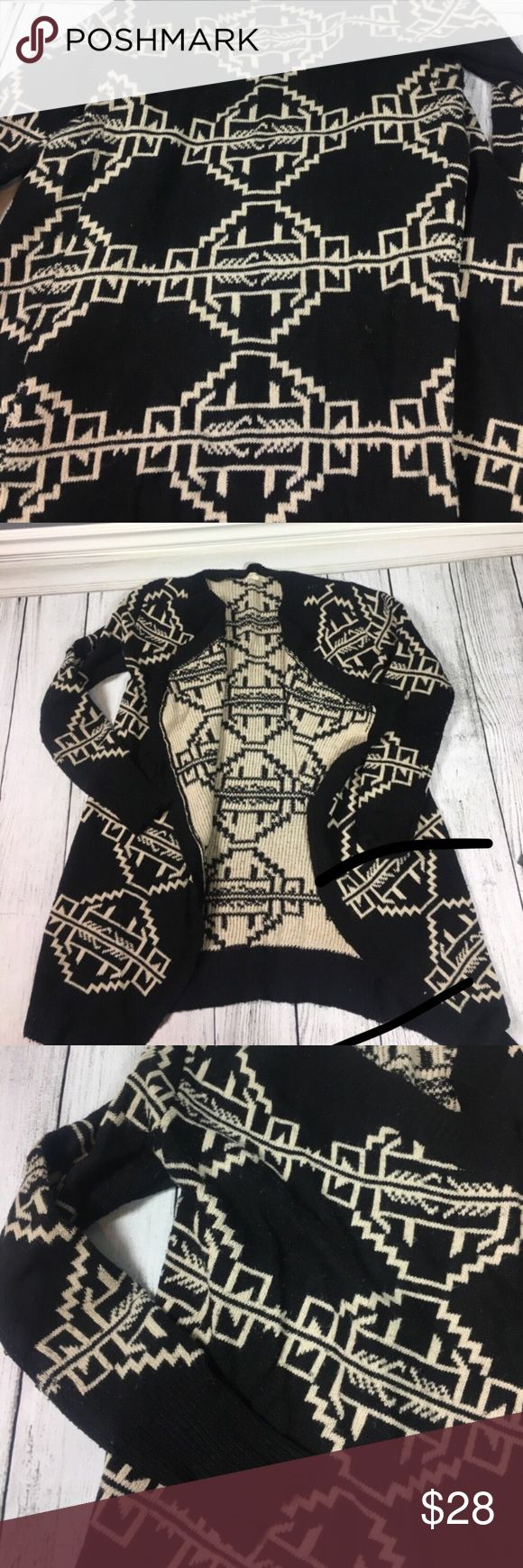 Gorgeous tribal print cardigan ❤️ Gorgeous tribal print cardigan. Super cute and cozy. This cardigan keeps you very warm since it is not very thin but more on the thick side. There is a small amount of pilling but not very much. Made out of  85% acrylic and 15% wool materials. COZY Sweaters Cardigans