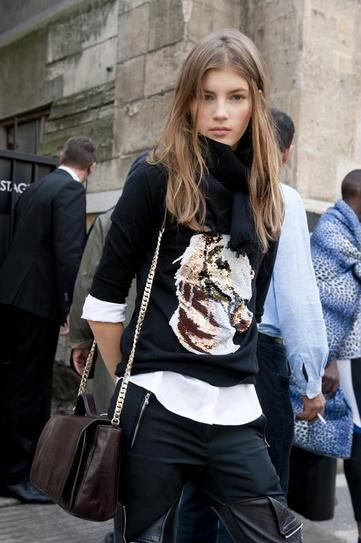 model off duty - paris street style - sequin embellished horse graphic sweater layered over a white button up worn with thigh high leather boots and a scarf