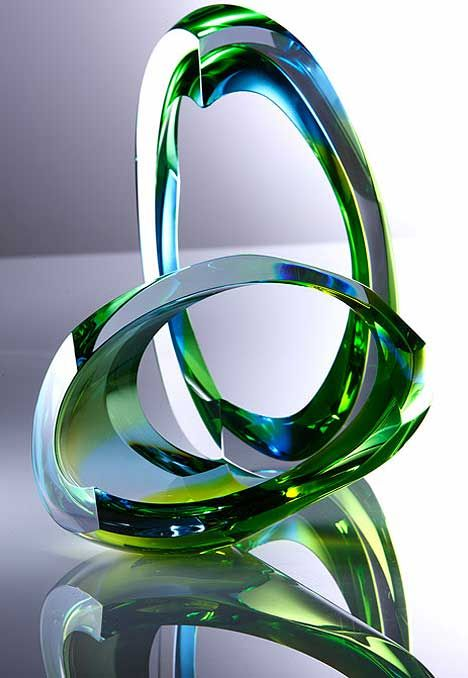 """""""Untitled"""" By glass designer Nikki Williams are hand-carved blown forms. The artist, recently influenced by work from Frank Gehry, puts her pieces through various stages of grinding and hand polishing to finally achieve the desired effect."""