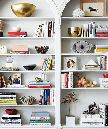 "Home Staging Tip: ""Remove 25 percent of your books entirely, and then rearrange what's left so that some books are vertical and some are stacked horizontally,"" says interior designer Christina Salaway."