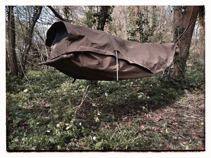 The Adventurer Bedroll shown in use as a covered, hammock, no tarp required.