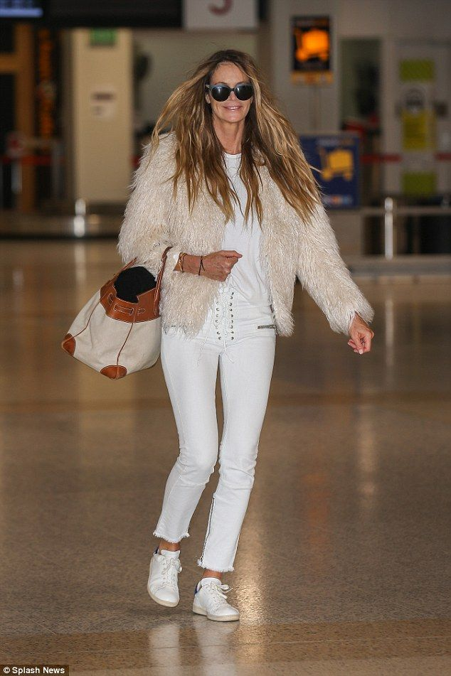 White on the mark! Elle Macpherson, 52, looked effortlessly stylish as she arrived in Melbourne airport wearing an entirely white ensemble