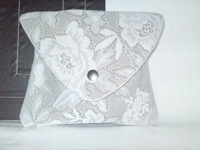 Handmade white lace clutch.