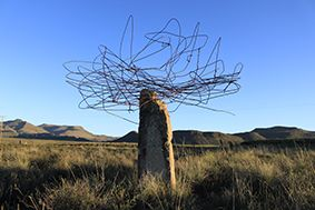 Rusted wire placed on a standing stone, South Africa