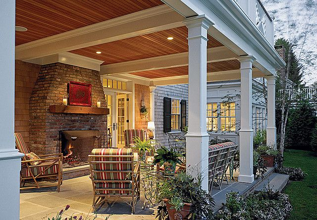 Love this porch with a fireplace