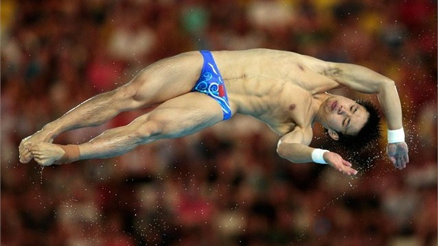 Bo Qiu of China competes in the men's 10m Platform Diving semi-final