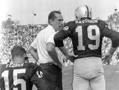 RAIDERS SUNDAY Oakland, CA Circa 1963 - Raiders Coach Al Davis and quarterback Cotton Davidson discussing important matters. (Ron Riesterer / Oakland Tribune)