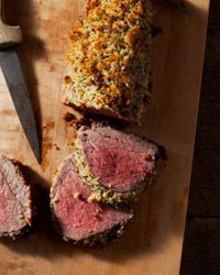 Parmesan and Herb-Crusted Beef Tenderloin Recipe on Food & Wine This glorious, pepper-rubbed roasted beef tenderloin is coated with herbed bread crumbs that have been mixed with anchovies, which add a nice pungent accent to the rich meat. The roast beef is served with a simple, flavorful red wine sauce.