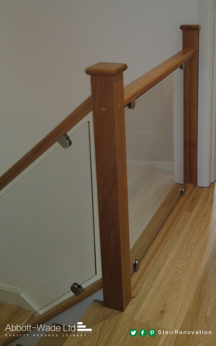 A beautiful oak and glass staircase with oak floorboards.