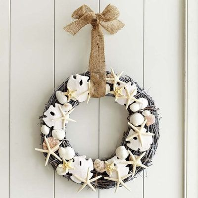Coastal Wreaths: Featuring a grapevine base, plenty of pretty shells, and a burlap ribbon, this beachy wreath is a must-have for a coastal home. | CoastalLiving.com